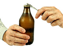 Man opening cold bottle of beer, over white Royalty Free Stock Images