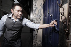 Man opening the door Stock Photography