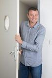 Man opening the door Stock Photography