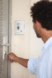 Man opening door with key Stock Image