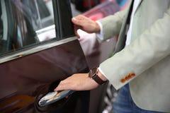 Man opening door of new car. Closeup stock photos