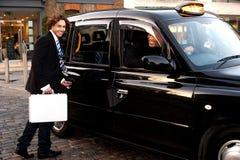 Man opening door of taxi cab Stock Photo
