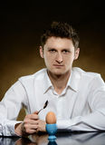 Man opening  an egg for eating Royalty Free Stock Photography