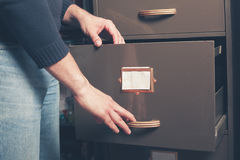Man opening file cabinet Stock Images