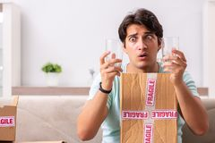 The man opening fragile parcel ordered from internet stock photos