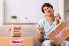 The man opening fragile parcel ordered from internet royalty free stock images