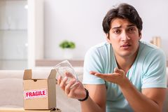 The man opening fragile parcel ordered from internet royalty free stock photography