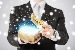 Man opening gift box Stock Image