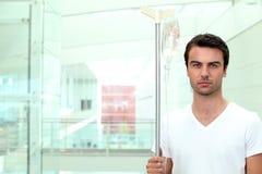 Man opening glass door Stock Images