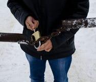 Man opening gold padlock on metal gates royalty free stock photos