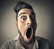 Man opening his mouth royalty free stock images