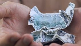 Man opening his shaking palms with few crumpled dollar banknotes, close up. Stock footage stock video footage