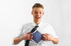 Man opening his shirt Stock Images