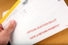 Man opening mail in ballot stock photography
