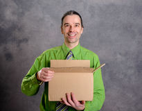 Man opening a package and looking surprised Stock Photography