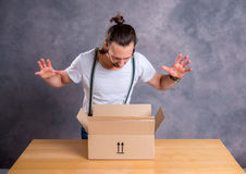 Man opening a package Royalty Free Stock Image