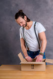 Man opening a package Royalty Free Stock Photos