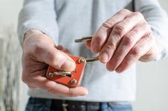 Man opening a padlock Stock Photos