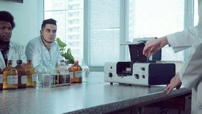 Man opening a science device. Person opening the case of medical research equipment stock video footage