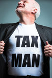 Man opening shirt with tax man text Royalty Free Stock Images