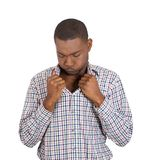 Man opening shirt to vent, it's hot, unpleasant, awkward situation Stock Image