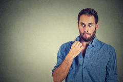Man opening shirt to vent, it's hot, unpleasant, Awkward Situation, Embarrassment Royalty Free Stock Image