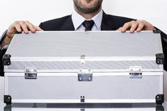 Man opening suitcase. A businessman opening a metal suitcase Royalty Free Stock Photography