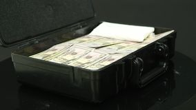 A man opens a black metal suitcase with money.  stock footage