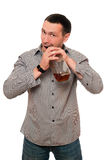 Man opens a bottle of whiskey Royalty Free Stock Photos