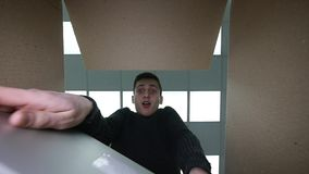Man Opens Box Smiling Stretching His Hands Inside of Enclosure , so Happy and Smiling.  stock footage