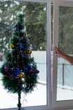 Man opens Christmas window Stock Photos