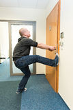 Man opens the door force Stock Image