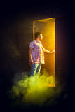 Man opens the door Stock Photo