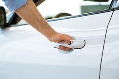 Man opens the door to a new car Royalty Free Stock Image