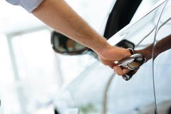 Man opens the door to a new car Stock Photography