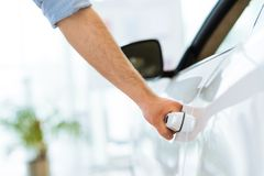 Man opens the door to a new car Stock Images