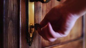 The man opens the door using key stock footage