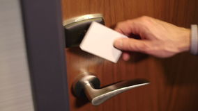 Man opens door using security key card Stock Images