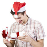 Man opens gift box Royalty Free Stock Image