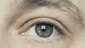 Man opens his eye, extreme close-up