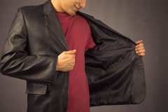 Man opens his jacket Stock Image