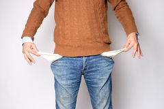 Man opens his pockets and there is no money Stock Photos