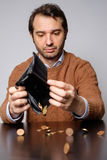 Man opens his wallet and there are few money. Inside Royalty Free Stock Images