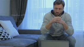 Man opens laptop at home stock video footage