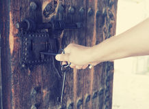 Man opens the lock Royalty Free Stock Image