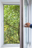 Man opens pvc window Royalty Free Stock Photos