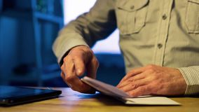 Man opens and sign a letter. To the document stock video footage