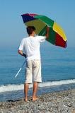 Man opens umbrella Royalty Free Stock Image