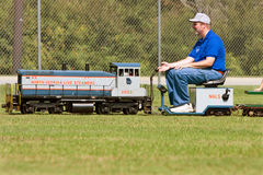 Man Operates Miniature Steam Engine Ride Stock Photos