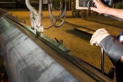 Man operating automated welding machine Royalty Free Stock Images